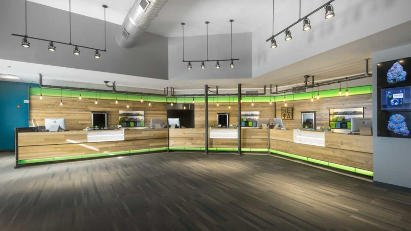 new england treatment access neta marijuana dispensary checkout counter product display interior design